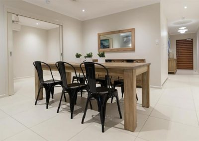 Solid teak dining table and black metal chairs