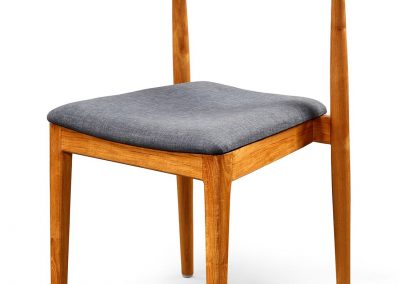 Gus stackable dining chair with fabric seat in Natural stain