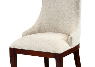 Royal fabric dining chair with medium brown stain